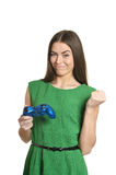 Beautiful woman with gamepad. Portrait of beautiful woman with gamepad on white background Royalty Free Stock Images