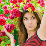 Beautiful woman in garden Stock Images