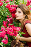Beautiful woman in garden Royalty Free Stock Photography