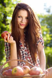 Beautiful woman  garden with apples Royalty Free Stock Image