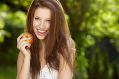 Beautiful woman  in the garden with apples Royalty Free Stock Image