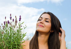 Beautiful woman in the garden with flowers. Royalty Free Stock Images