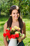 Beautiful woman in the garden with flowers. Stock Image