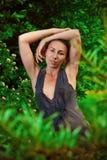 Beautiful woman in garden Stock Image