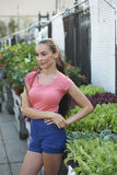 Beautiful Woman At Garden Shop Stock Photography