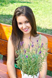 Beautiful woman in the garden sitting on a bench. Royalty Free Stock Photos
