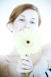 Beautiful woman with gerbera flower Royalty Free Stock Image