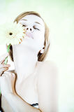 Beautiful woman with gerbera flower Stock Images