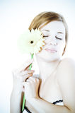 Beautiful woman with gerbera flower Royalty Free Stock Photos