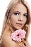 The beautiful woman with a Gerbera flower isolated on white Royalty Free Stock Image