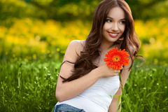 Beautiful Woman With Gerbera Flower Enjoying Nature. Royalty Free Stock Images