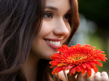 Beautiful Woman With Gerbera Flower Enjoying Nature. Stock Image