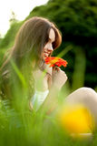 Beautiful Woman With Gerbera Flower Enjoying Nature against Natu Royalty Free Stock Photography