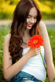 Beautiful Woman With Gerbera Flower Enjoying Nature against Natu Stock Image