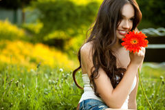 Beautiful Woman With Gerbera Flower Enjoying Nature against Natu Stock Images