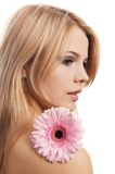 The beautiful woman with a Gerbera flower isolated on white Stock Image