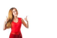 Beautiful woman with a gesture of super. Beautiful woman in red with a gesture super Royalty Free Stock Photo