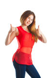 Beautiful woman with a gesture of super. Beautiful woman in red with a gesture super Stock Image