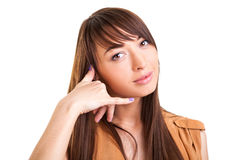 Beautiful woman gesturing call me Royalty Free Stock Images