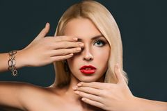 beautiful woman gesturing and closing her eye, Royalty Free Stock Images