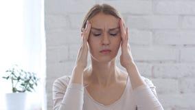 Beautiful Woman Gesturing Headache, Stress at Work. High quality Stock Image