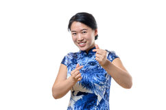 Beautiful woman gesturing a love sign. Beautiful Chinese woman in traditional dress gesturing a love sign with fingers Stock Image