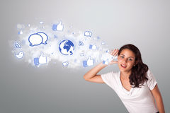 Beautiful woman gesturing with social network icons. Beautiful young woman gesturing with social network icons Stock Photo