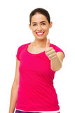 Beautiful Woman Gesturing Thumbs Up Over White Background Royalty Free Stock Photography