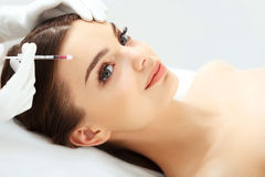 Beautiful woman gets botox injections.. Beautiful woman gets botox injections. Cosmetology. Beauty face Stock Image