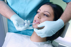 Beautiful woman gets an injection in her face Royalty Free Stock Images