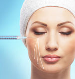 Beautiful woman gets an injection in her face Royalty Free Stock Photo