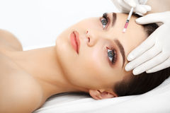 Beautiful Woman gets Injection In Her Face. Cosmetic Surgery Royalty Free Stock Photos