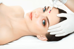 Beautiful Woman gets Injection In Her Face. Cosmetic Surgery Stock Images