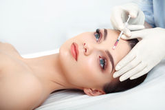 Beautiful Woman gets Injection In Her Face. Cosmetic Surgery Royalty Free Stock Photography