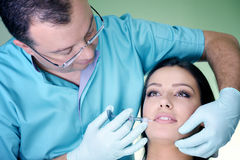 Beautiful woman gets an injection in her face Royalty Free Stock Photography