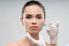 Beautiful woman gets injection in her face Royalty Free Stock Photo