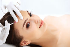 Beautiful woman gets injections. Cosmetology. Stock Photography