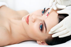 Beautiful woman gets injections. Cosmetology. Beauty Face Royalty Free Stock Images