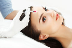 Beautiful woman gets injections. Cosmetology. Beauty Face Stock Photos