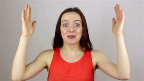 Beautiful woman gets shock on white background stock video footage