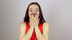 Beautiful woman gets shock on white background stock video