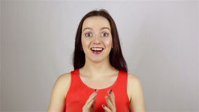 Beautiful woman gets shock on white background stock footage