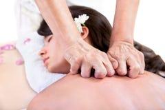 Beautiful woman getting a back massage Stock Photo