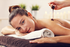 Beautiful woman getting chocolate massage in spa. Picture of beautiful women getting chocolate massage in spa Royalty Free Stock Photo
