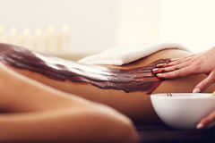Beautiful woman getting chocolate massage in spa. Picture of beautiful women getting chocolate massage in spa Stock Image