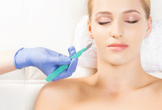 Beautiful woman getting face lifting operation Royalty Free Stock Image
