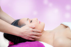 Beautiful woman is getting a facial massage in the spa Stock Images
