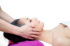 Beautiful woman is getting a facial massage Stock Photo