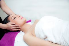 Beautiful woman is getting a facial massage in the spa salon. The beautiful woman is getting a facial massage in the spa salon royalty free stock photos