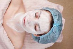 Beautiful woman getting facial treatment Royalty Free Stock Images